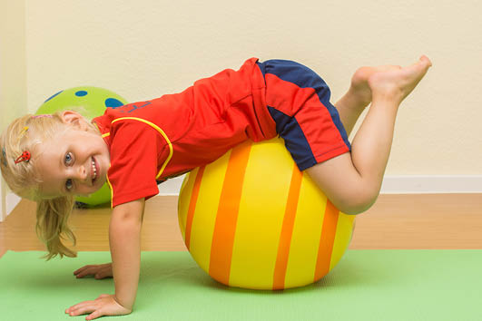 Child on an inflatable ball